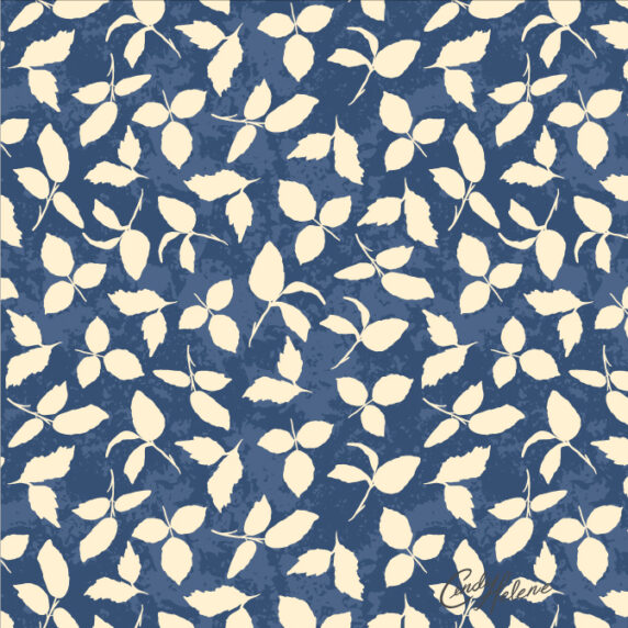 White cream tossed leaves on a textured blue background